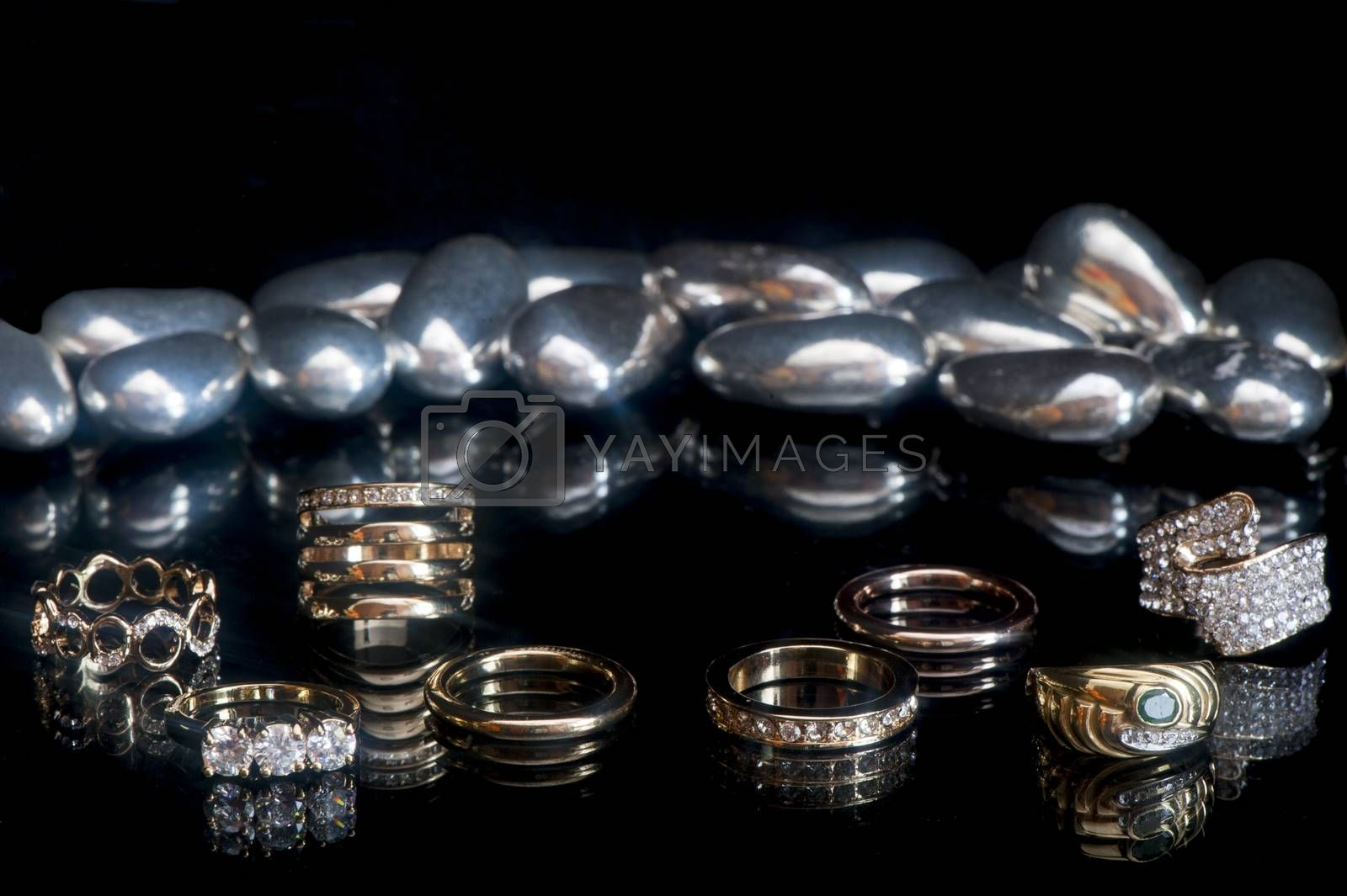a wedding ring on a black background