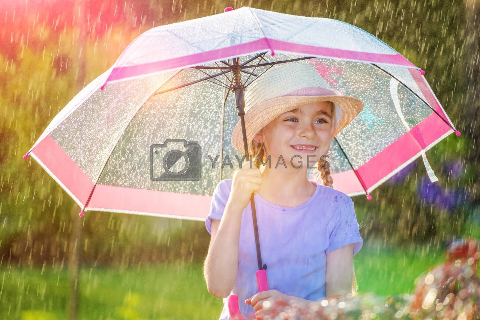 Rainy Weather Outdoor Fun. Young Caucasian Girl with Pink Umbrella.