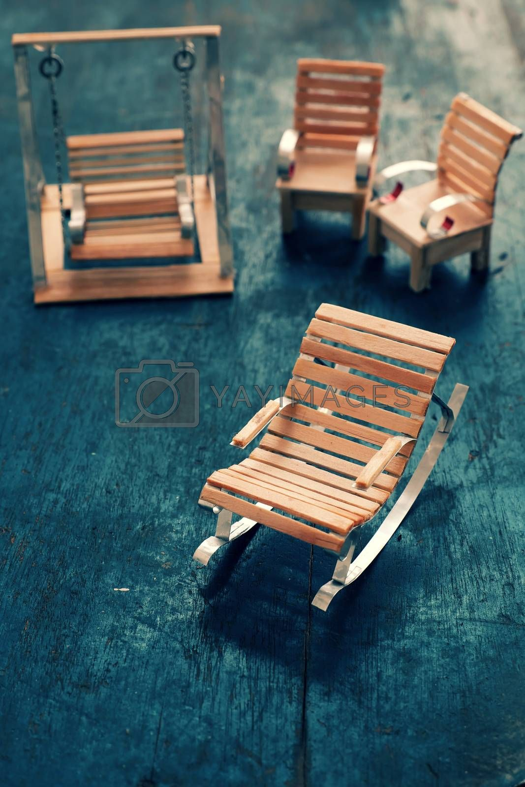 Amazing miniature handmade product for interior design, mini furniture make from wood stick on wooden background, small chair so cute, a hobby leisure
