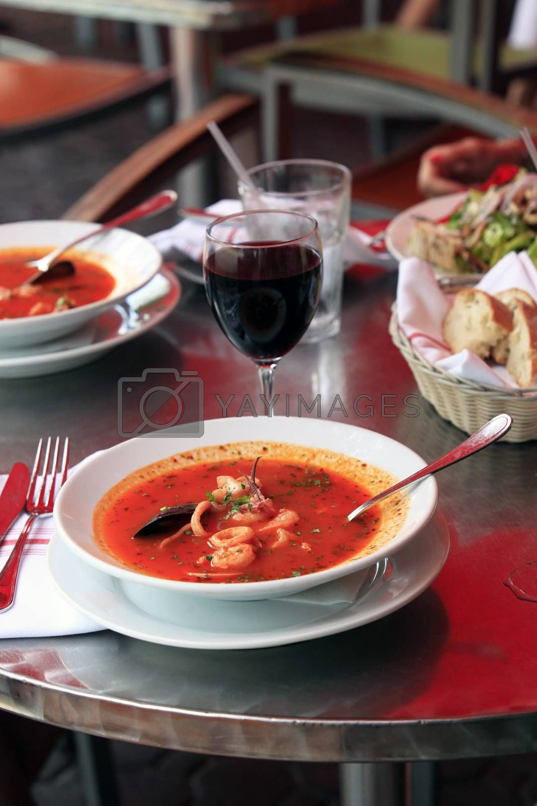Bowl of spicy fish soup with tomatoes and mussels