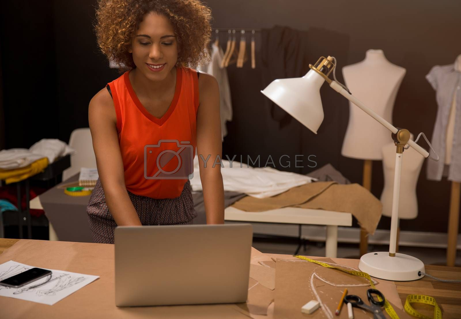 A young fashion designer working on her atelier