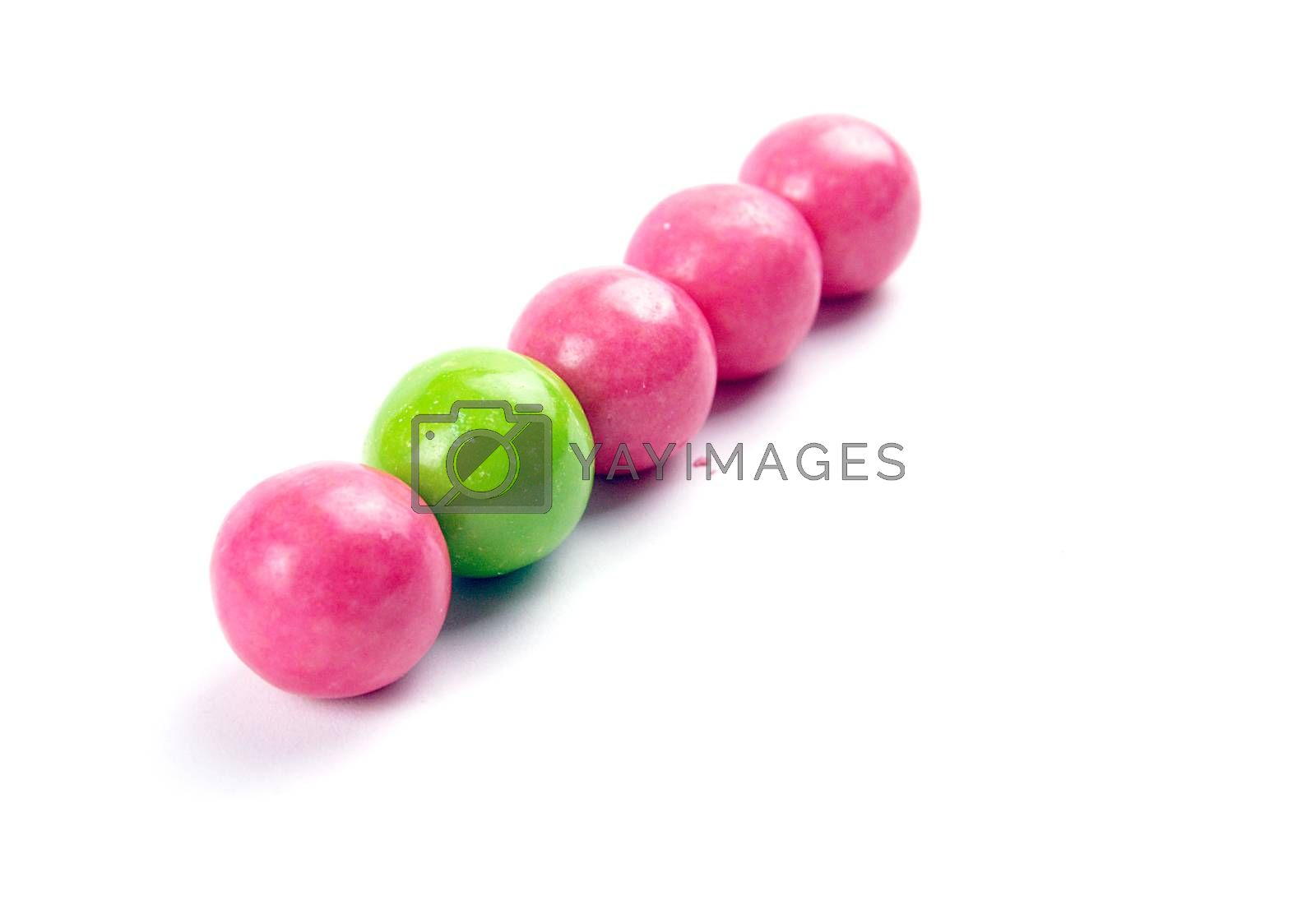 Royalty free image of A pile of colorful gumballs on a white background. by nehru