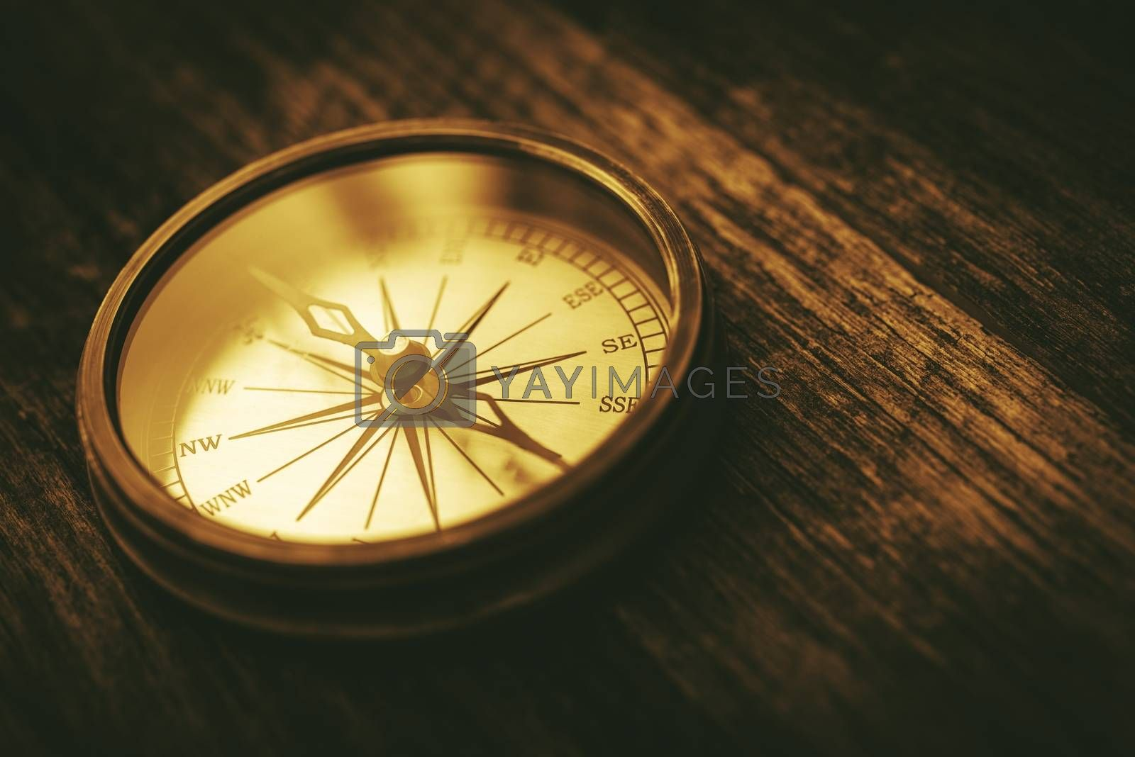 Vintage Navigation Technology. Old Metallic Compass Device on Aged Wood Boards.