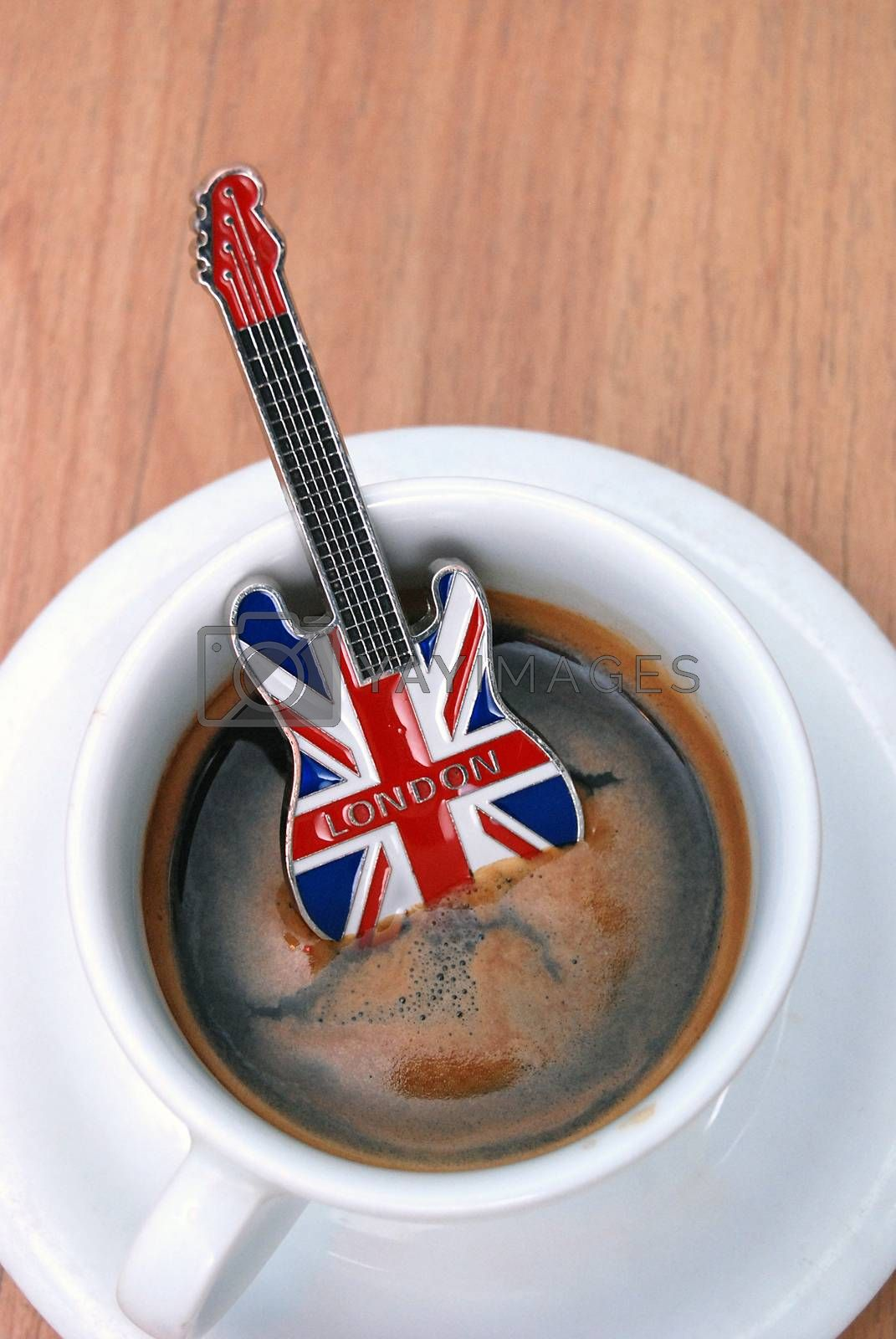 Royalty free image of guitar souvenir from london in espresso cup by nehru