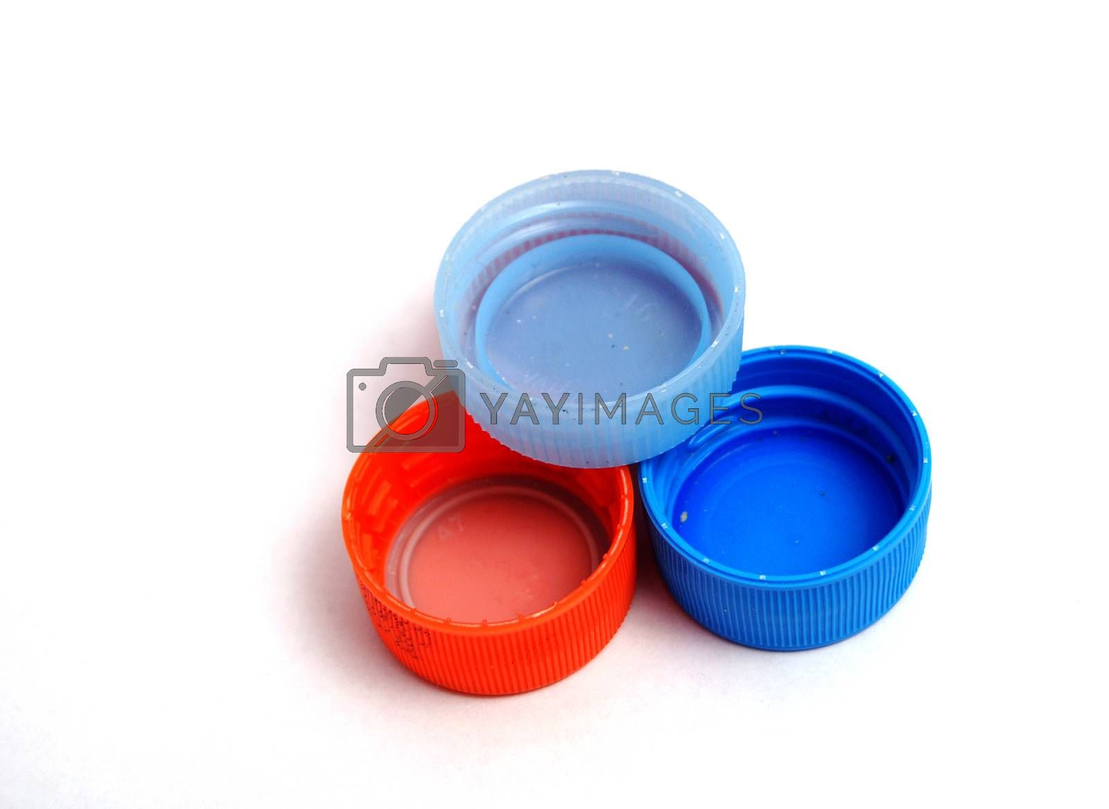 Royalty free image of Plastic bottle caps on white background. selective focus by nehru