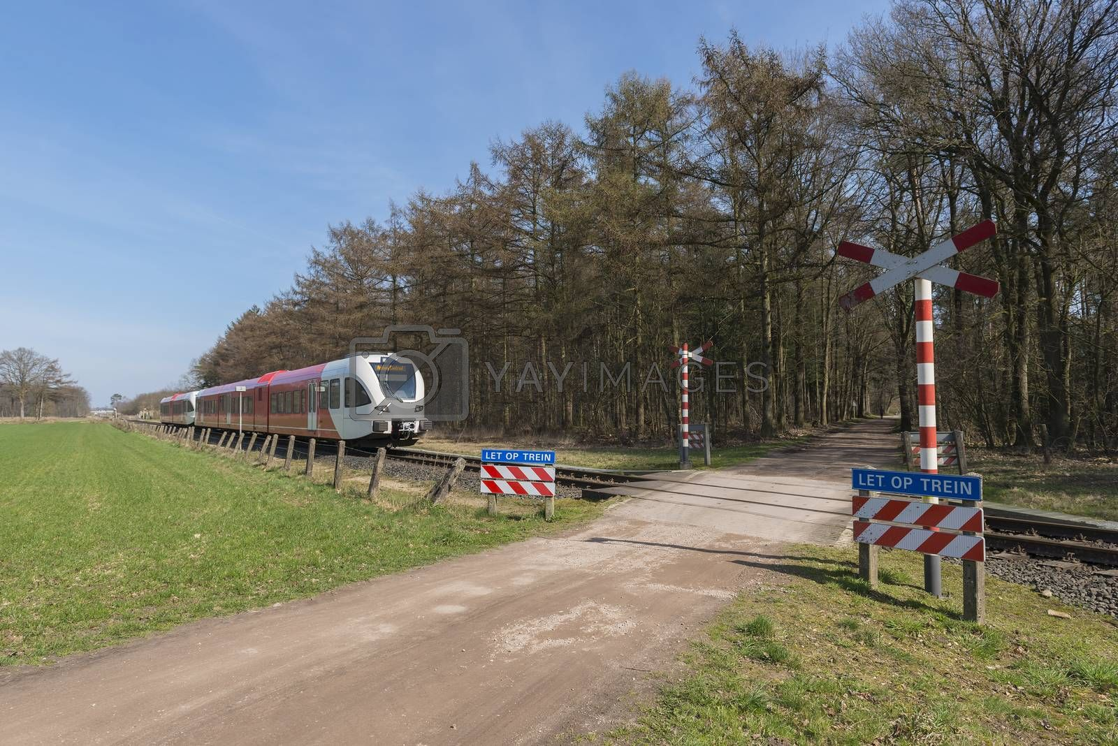 Unguarded, light rail railway crossing without barriers and warning lights in the East of the Netherlands