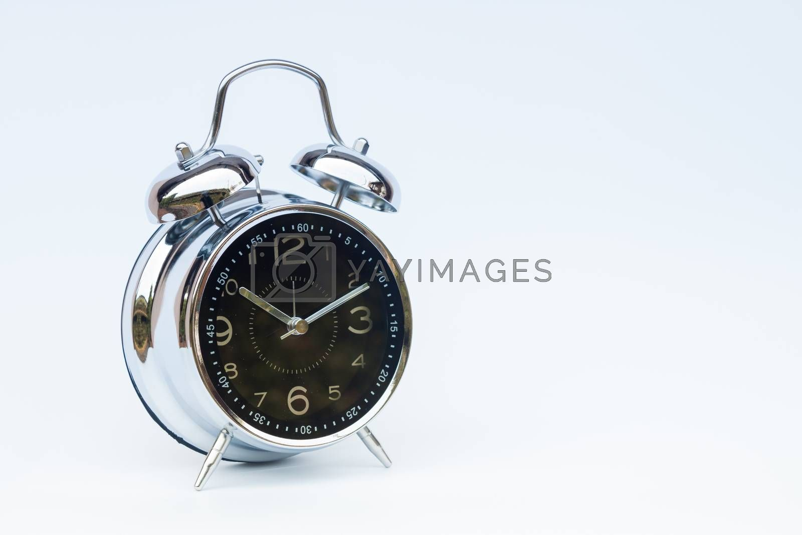 Alarm clock isolated on white background by punsayaporn