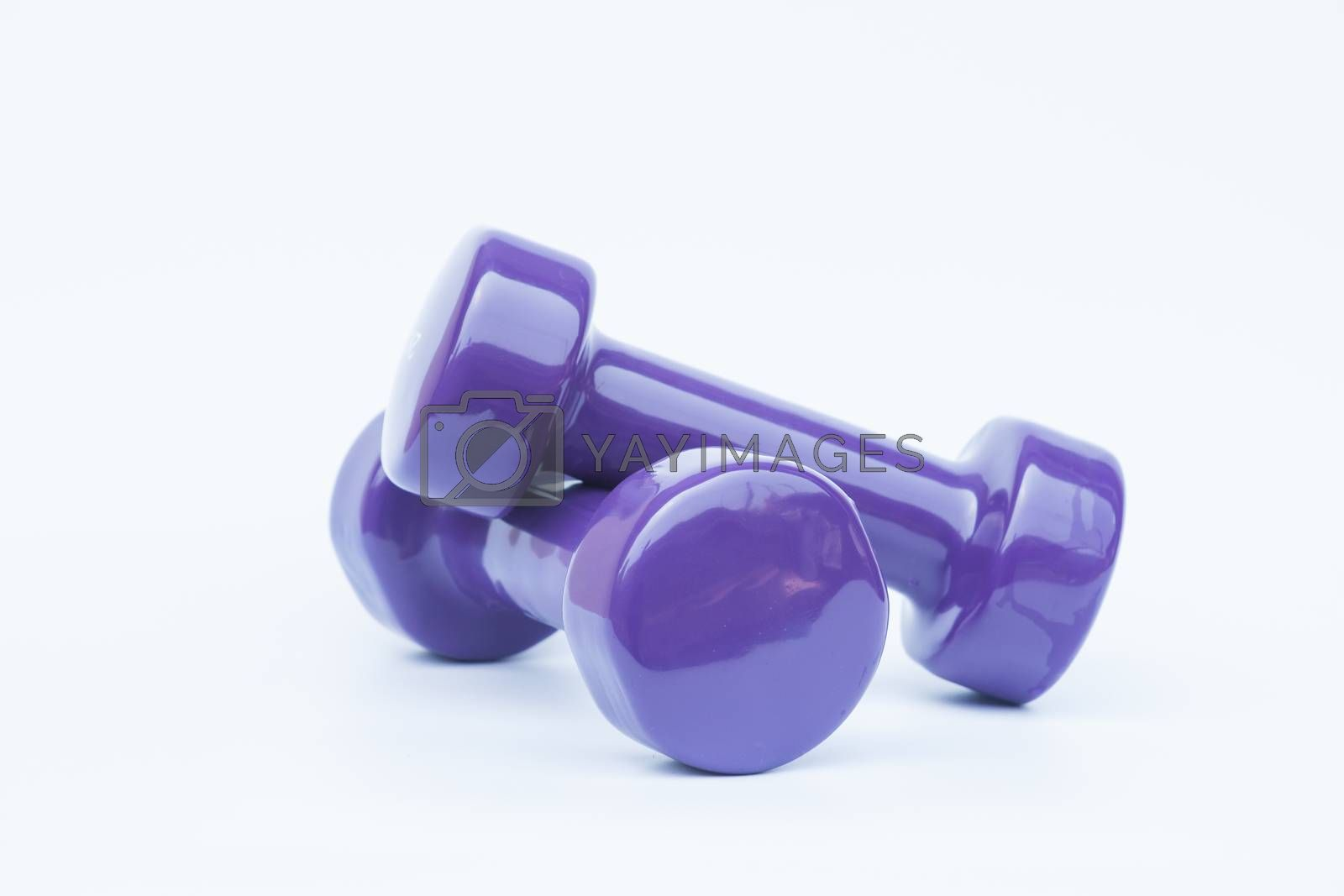 Dumbbell weights isolated on white background by punsayaporn