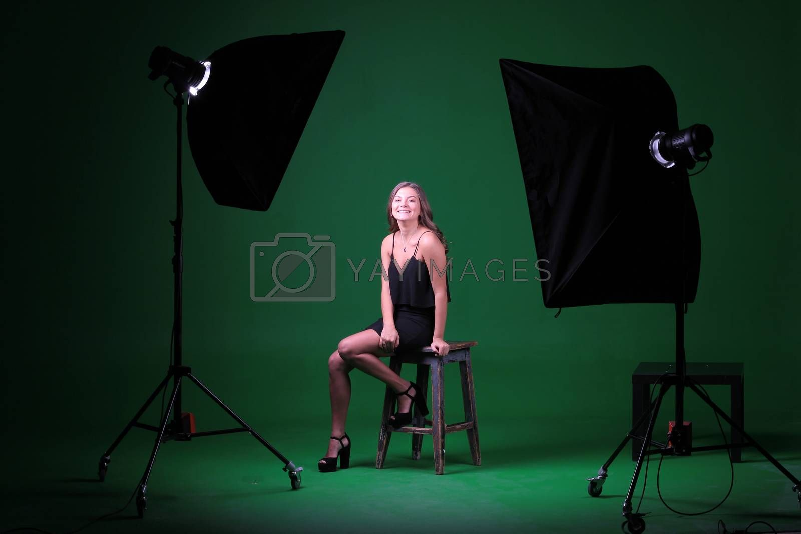 The process of shooting girls in the Studio on a green background by mdsfotograf