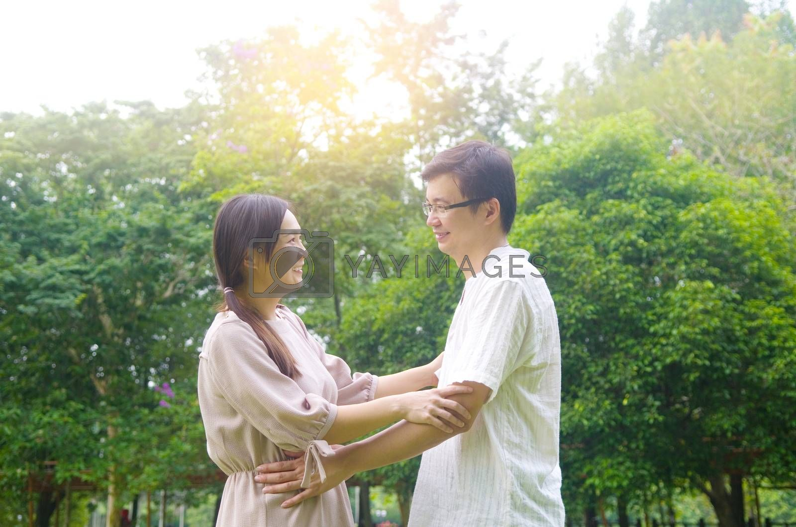 Asian romance couple in love at outdoor park.