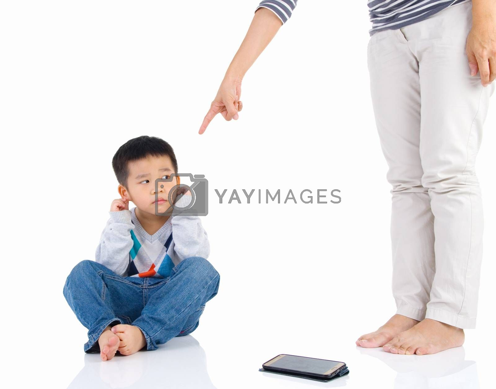 Education of the child. mother scolds her child boy playing game on smartphone. family relationships