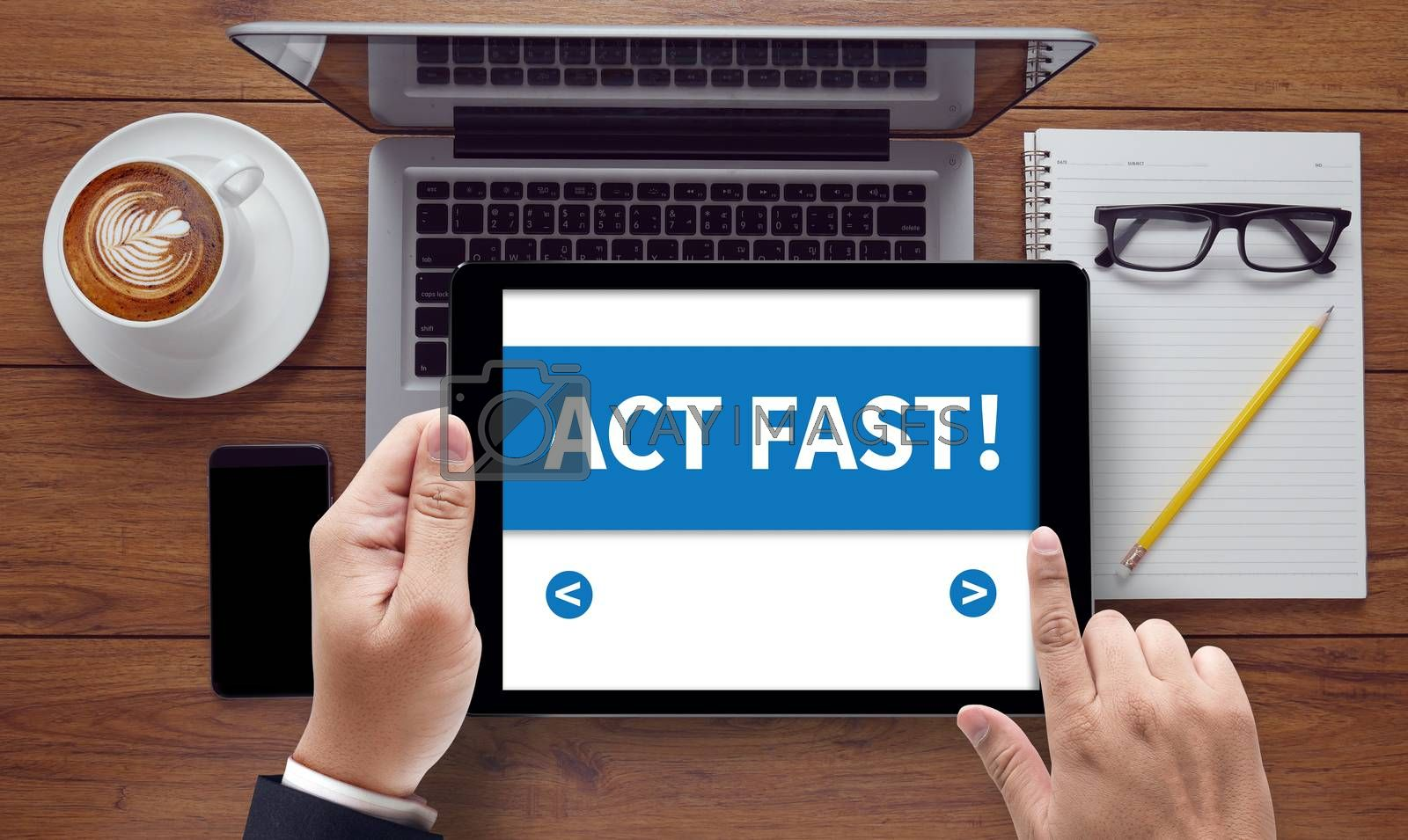 ACT FAST!, on the tablet pc screen held by businessman hands - online, top view
