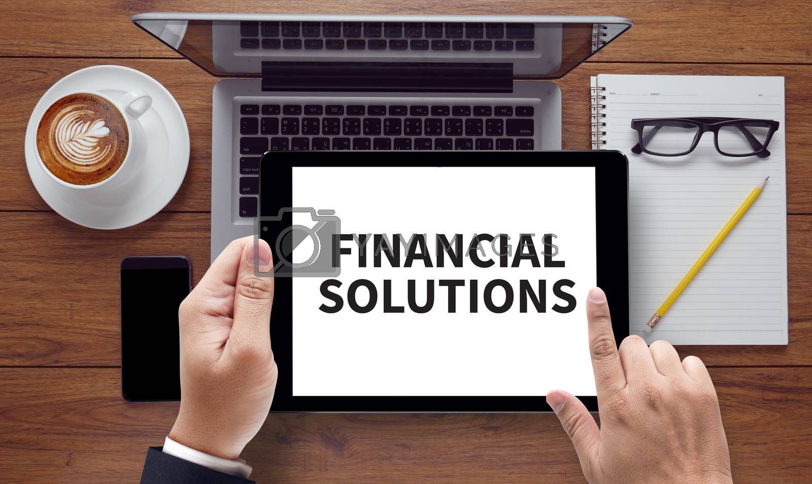 FINANCIAL SOLUTIONS , on the tablet pc screen held by businessman hands - online, top view
