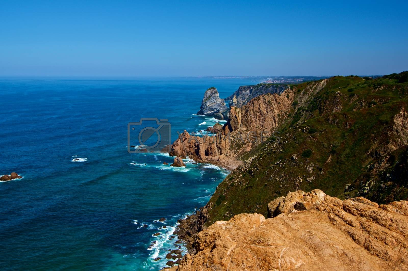 Impressive Landscape with Stormy Ocean and High Sheer Cliffs over Horizon in Sunny Day Outdoors. Cabo da Roca, Portugal