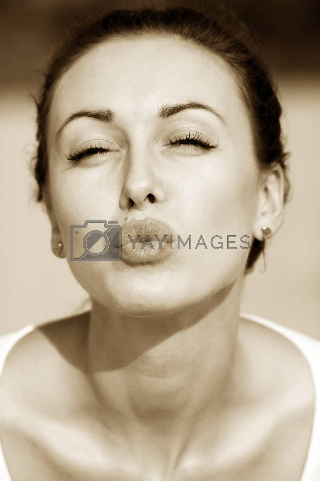 Pretty young caucasian girl sending kiss