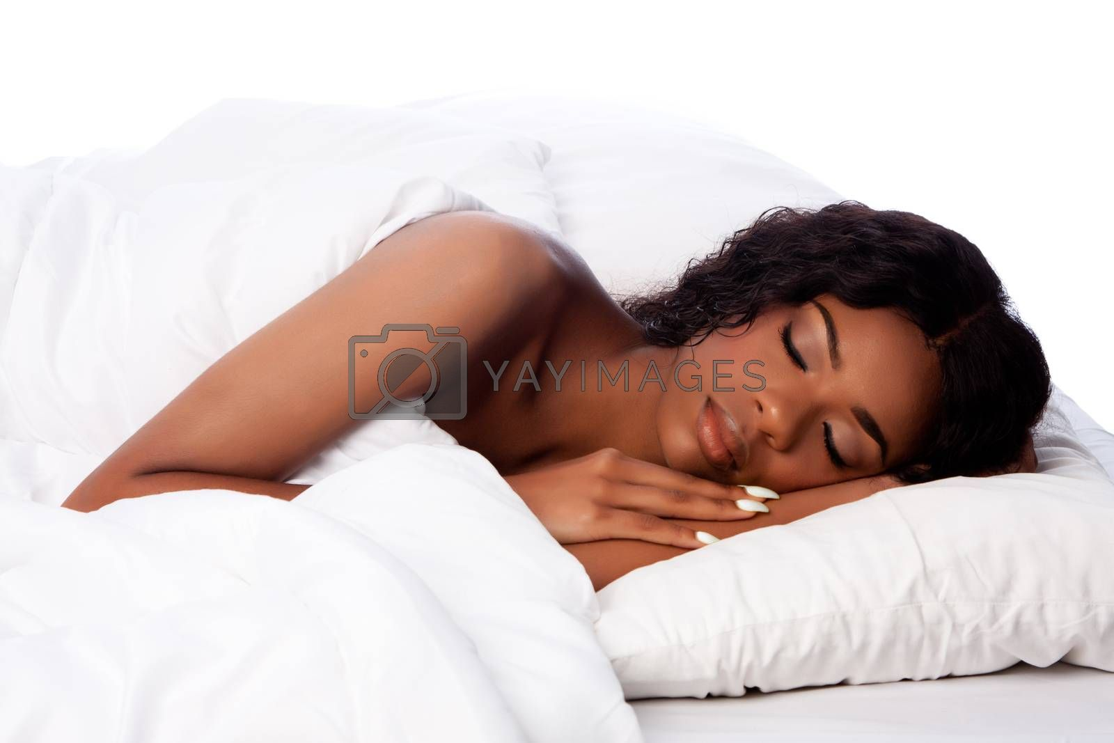 Beautiful woman deeply asleep and dreaming on comfortable soft fluffy white pillow bed.