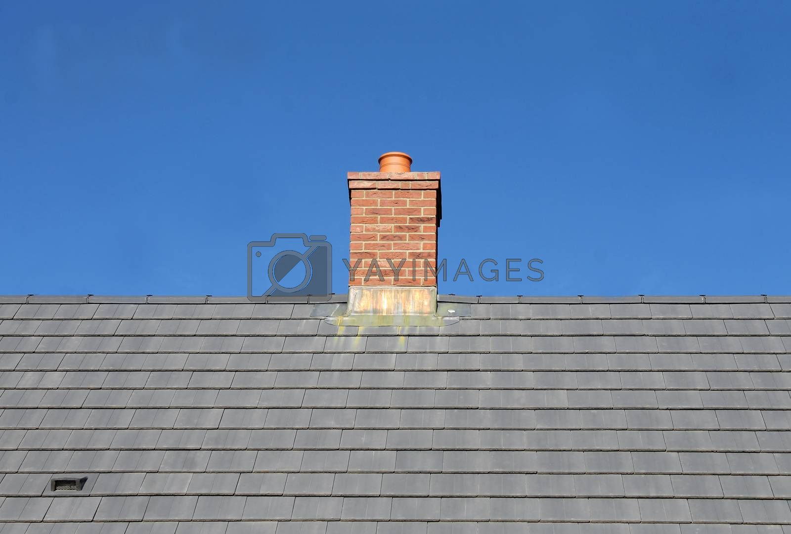 Royalty free image of Gray tile roof and chimney by speedfighter