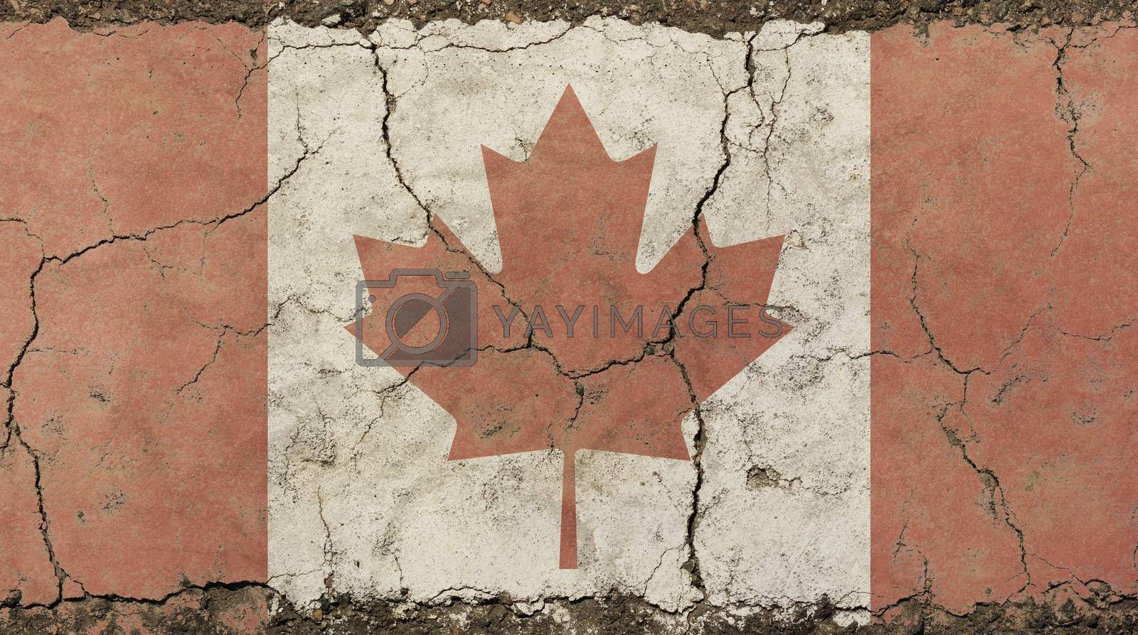 Old grunge vintage dirty faded shabby distressed Canadian Canada flag with red maple leaf over white background on broken concrete wall with cracks
