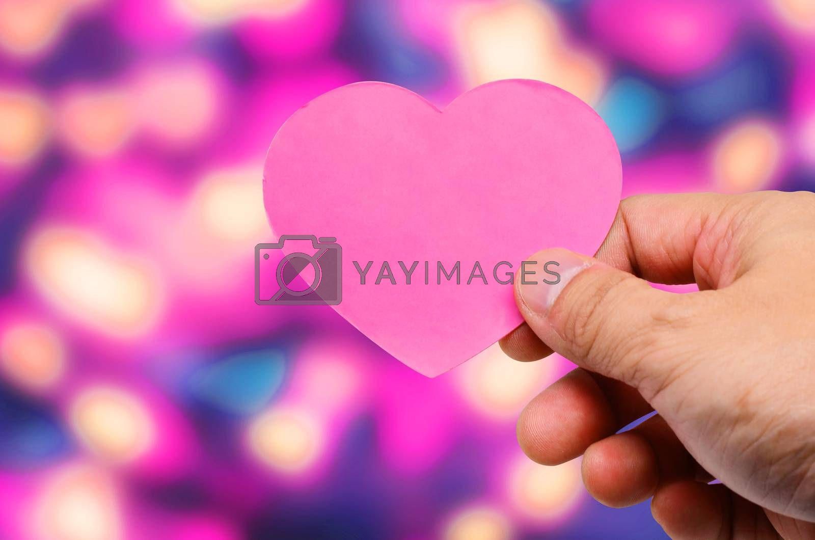 Hand holding a tag hearts valentines day