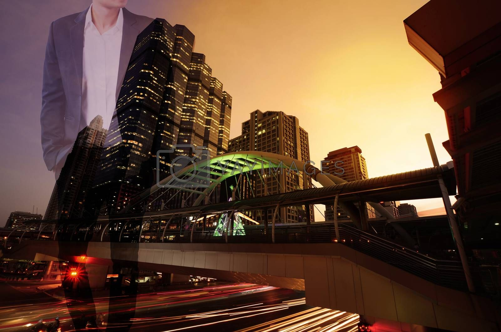 Double exposure of businessman stand up and think idea about business, cityscape, urban and street in the night or twilight as thoughtful concept.