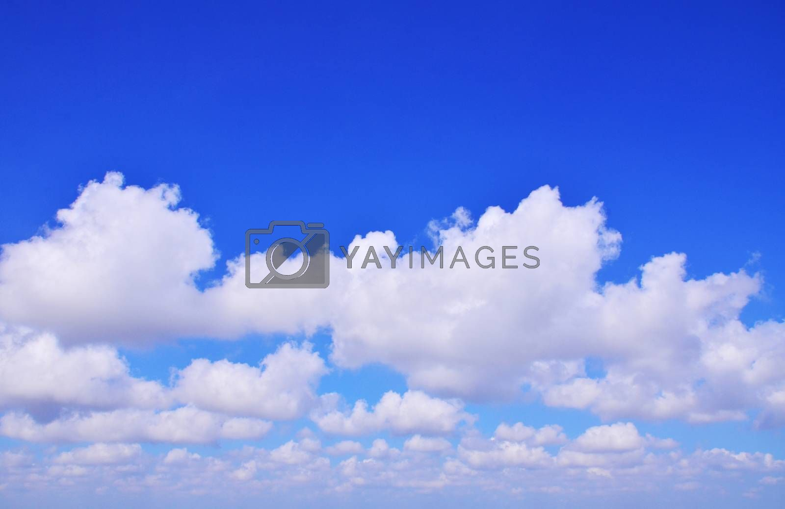 The vast blue sky with clouds