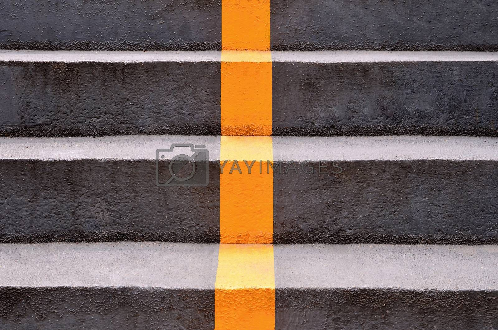 concrete stairs with yellow lines dividing the way down.