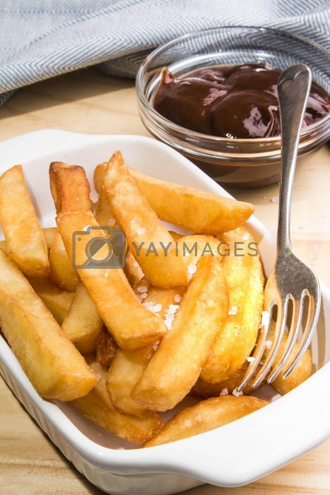 french fries with british brown sauce in a bowl
