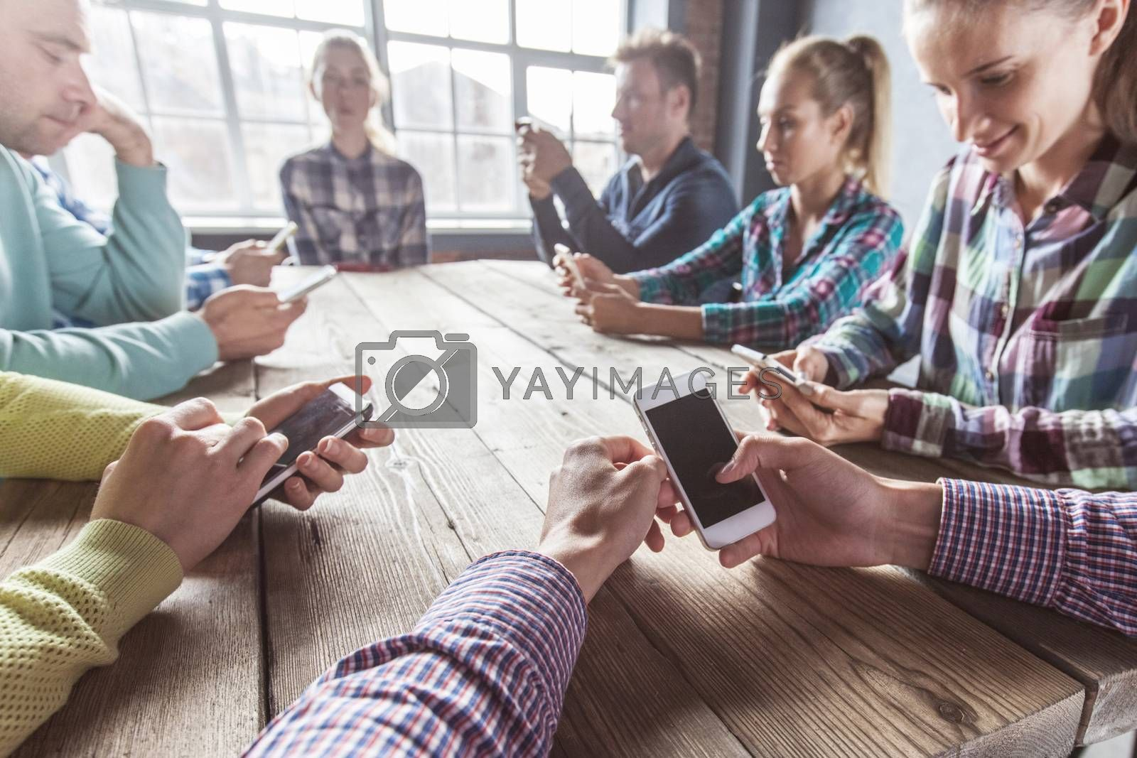 Detail of hipster modern business people using smart phone in loft office