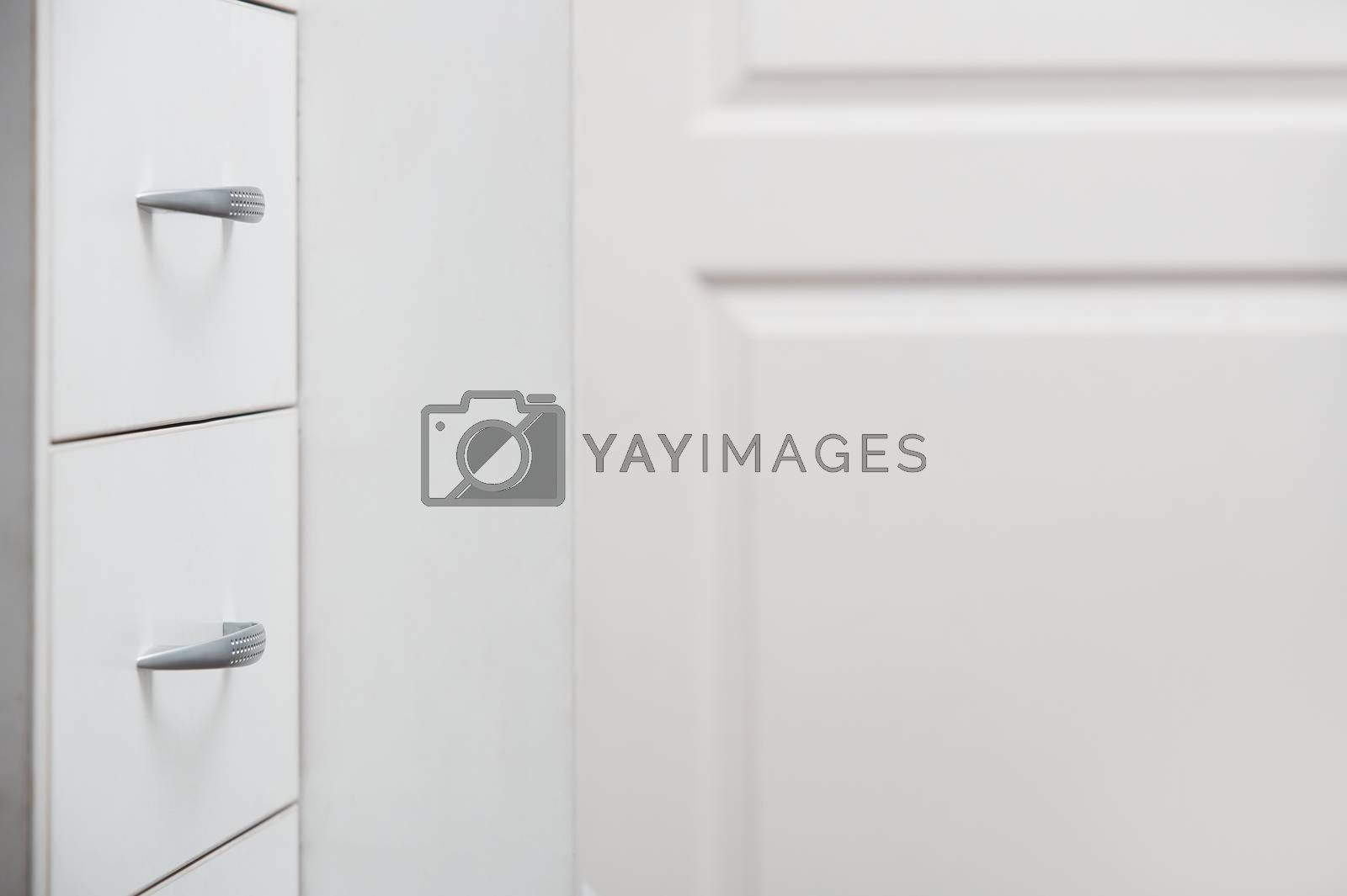 Cabinet with sliding trays and chrome handles. Horizontal photo