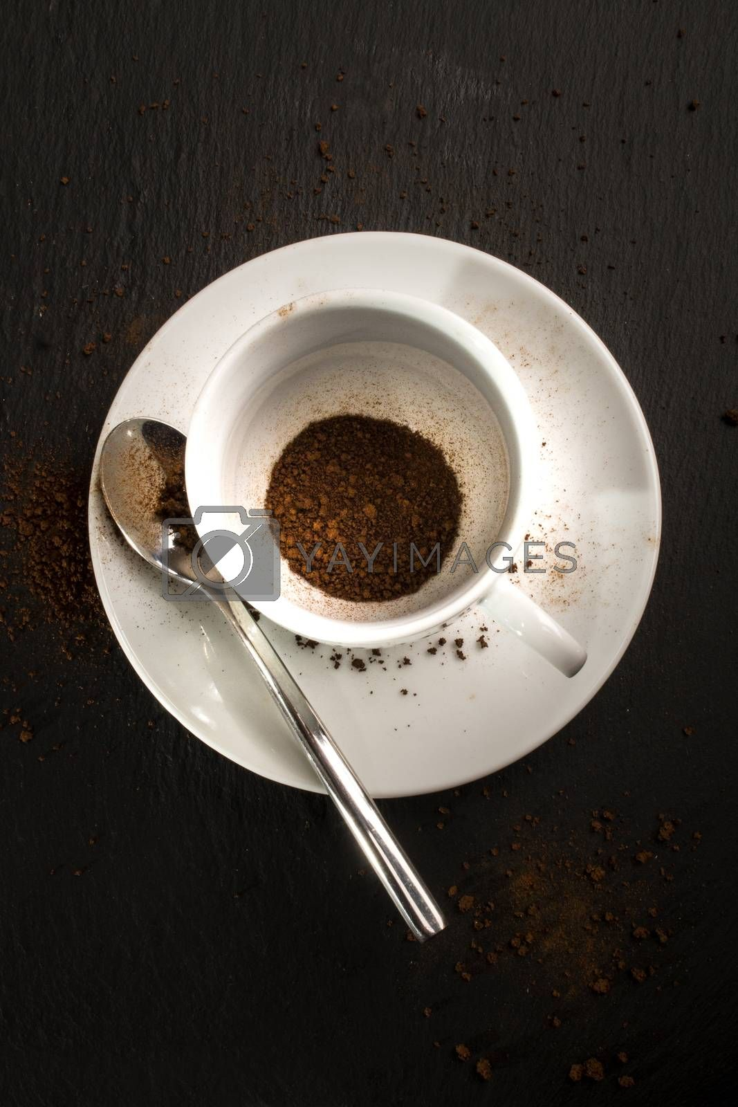 coffee cup and spoon with instant coffee on slate