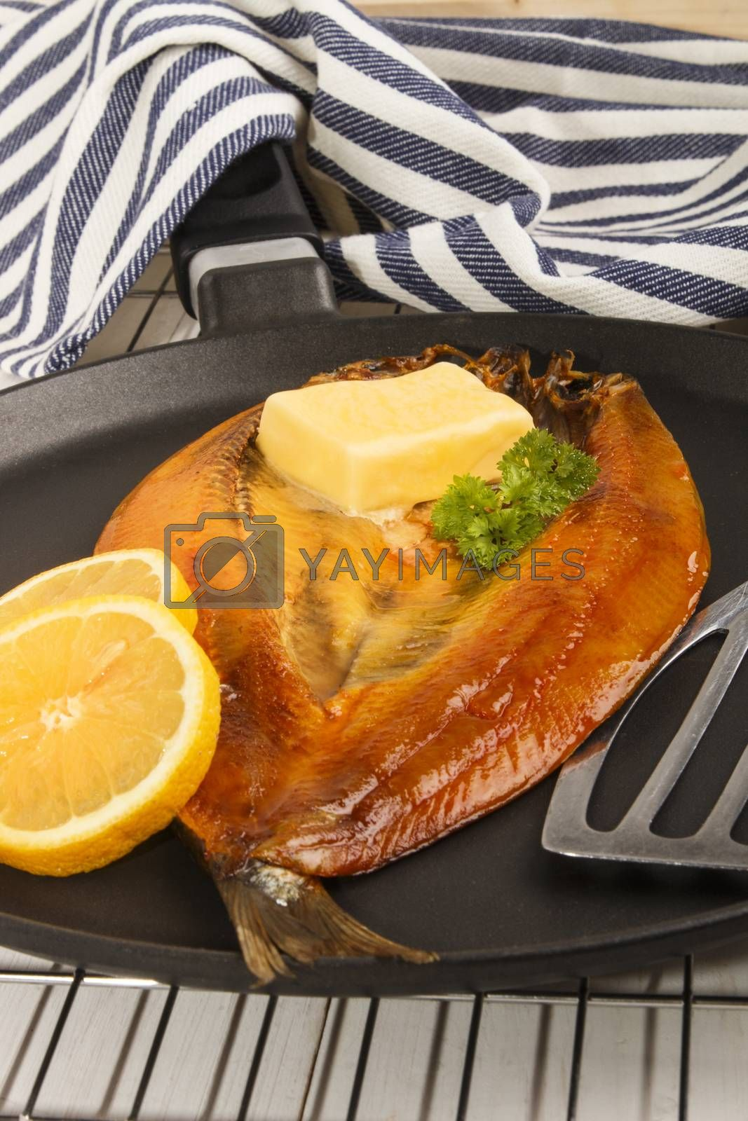 smoked warm scottish kipper with butter in a pan