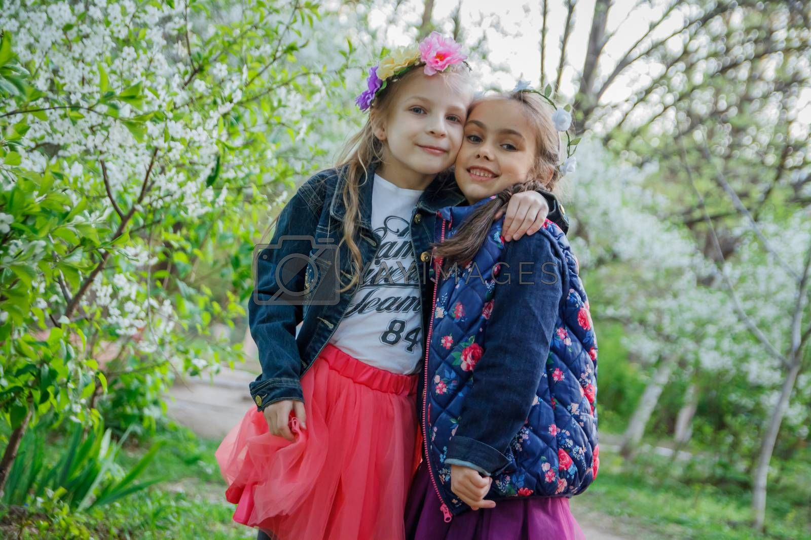 Two happy girls enjoying spring garden