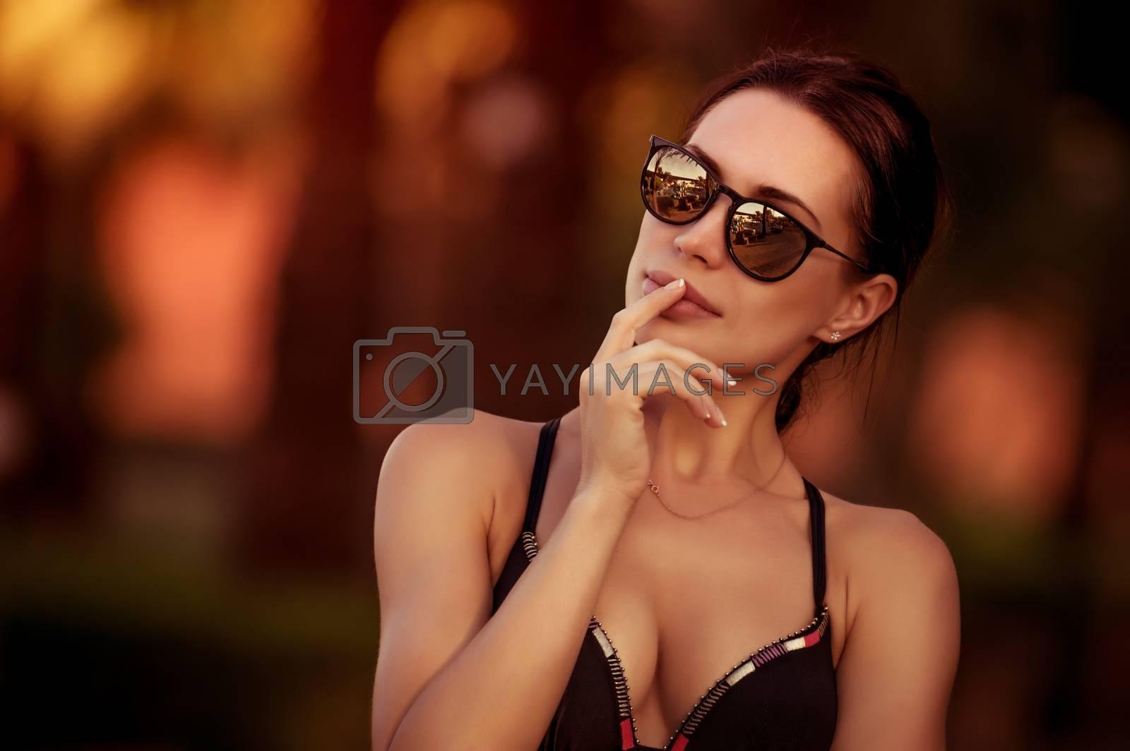 Fashion woman portrait, beautiful woman wearing stylish sunglasses and swimsuit, gorgeous female model outdoors, summer vacation look