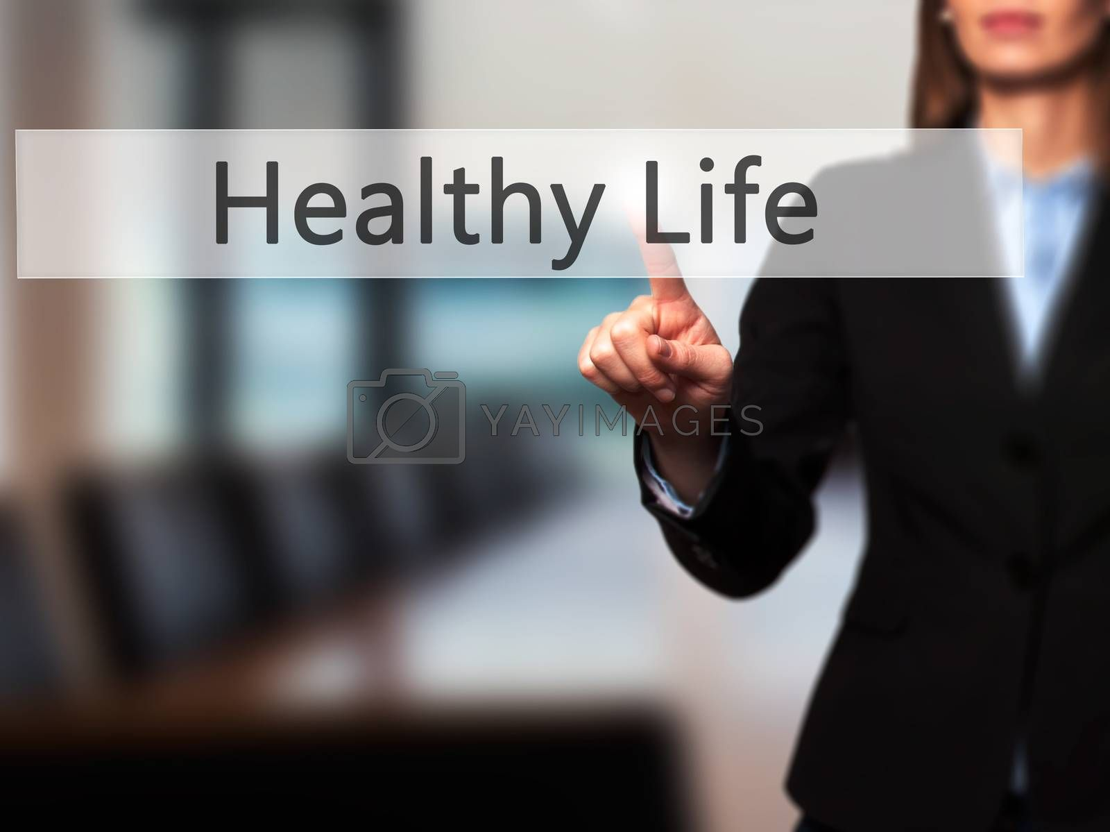 Healthy Life - Businesswoman hand pressing button on touch screen interface. Business, technology, internet concept. Stock Photo