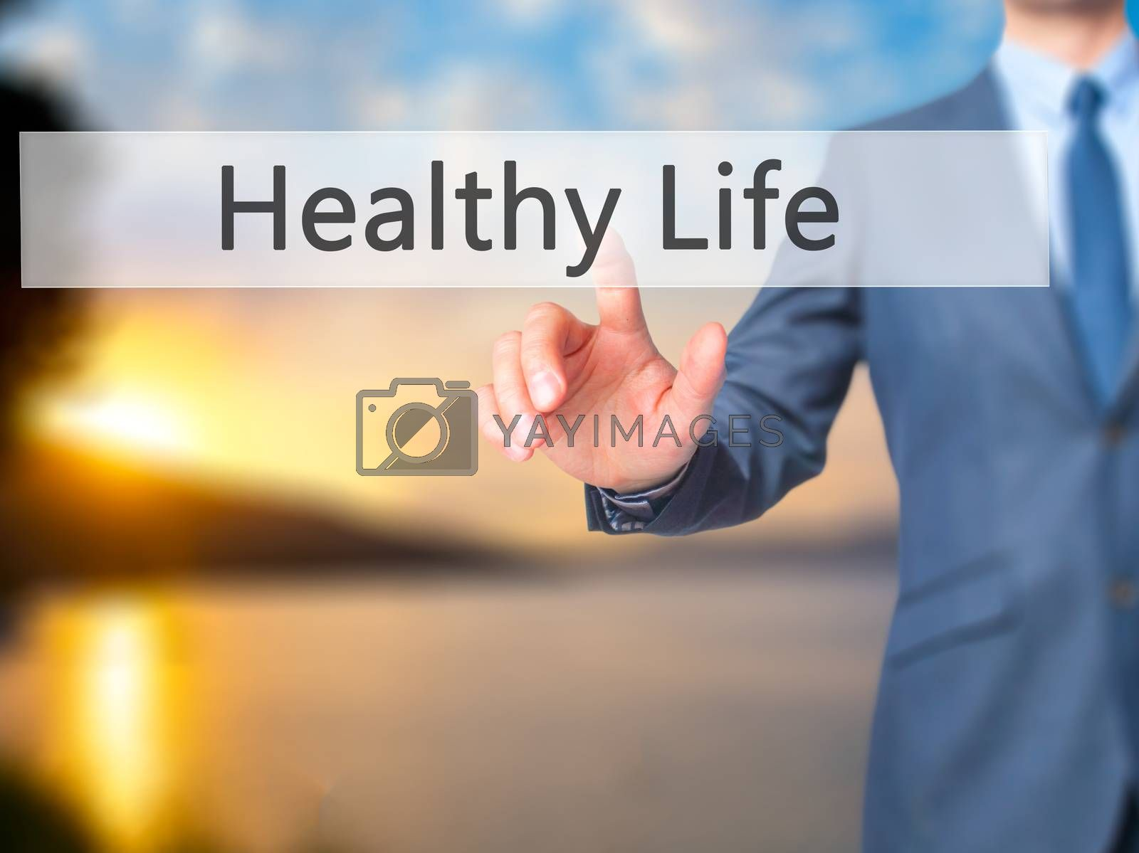 Healthy Life - Businessman hand pressing button on touch screen interface. Business, technology, internet concept. Stock Photo
