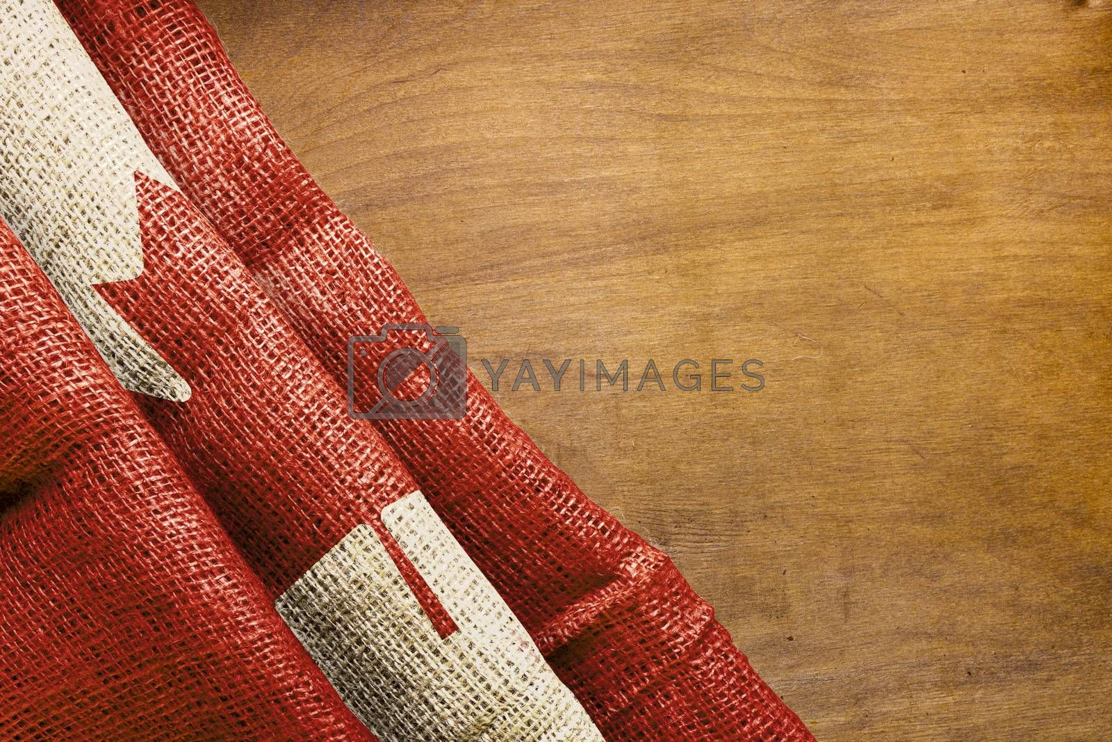 Flag of Canada on a wooden background.
