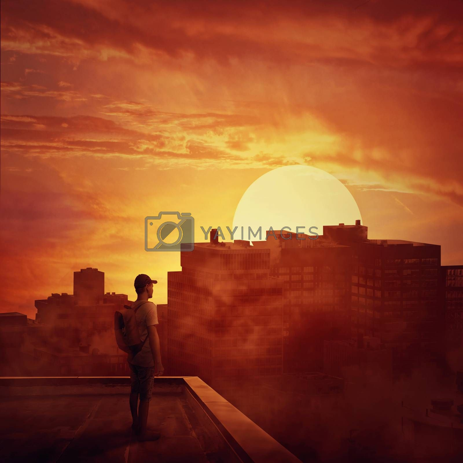 Young boy stay on the rooftop looking at the sunset. Mysterious place over the misty city