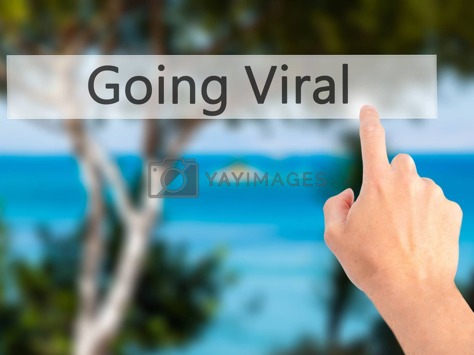 Going Viral - Hand pressing a button on blurred background conce by jackald