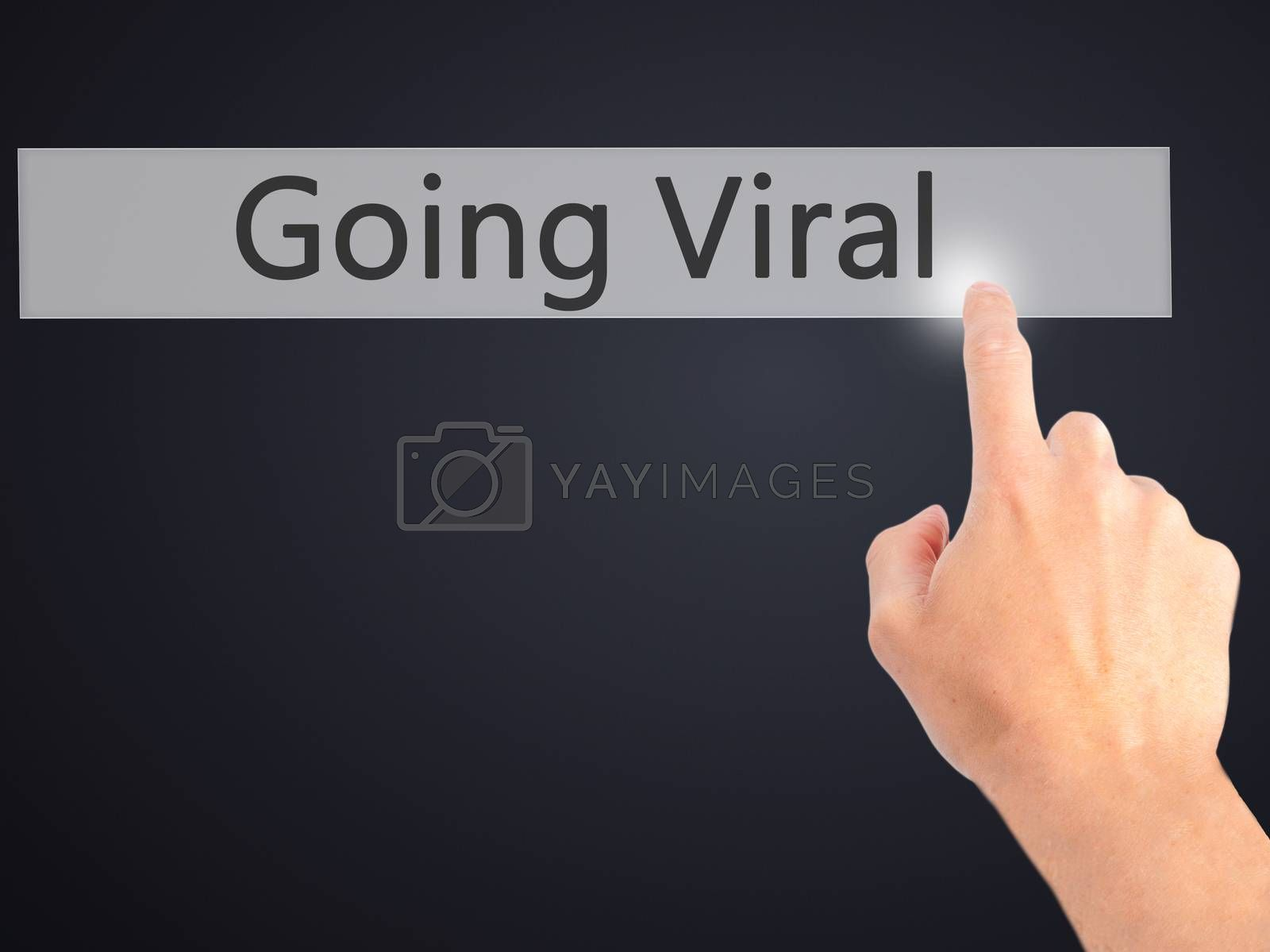 Going Viral - Hand pressing a button on blurred background conce by netsay.net
