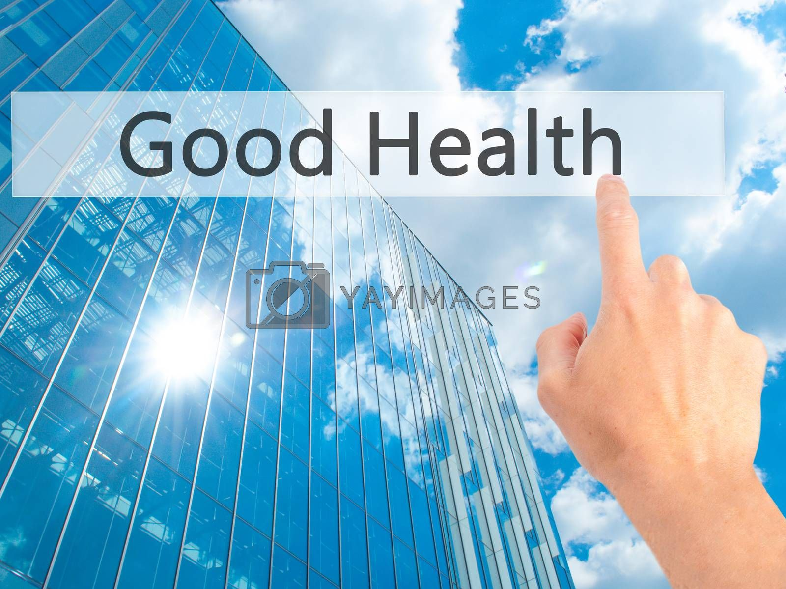 Good Health - Hand pressing a button on blurred background conce by jackald
