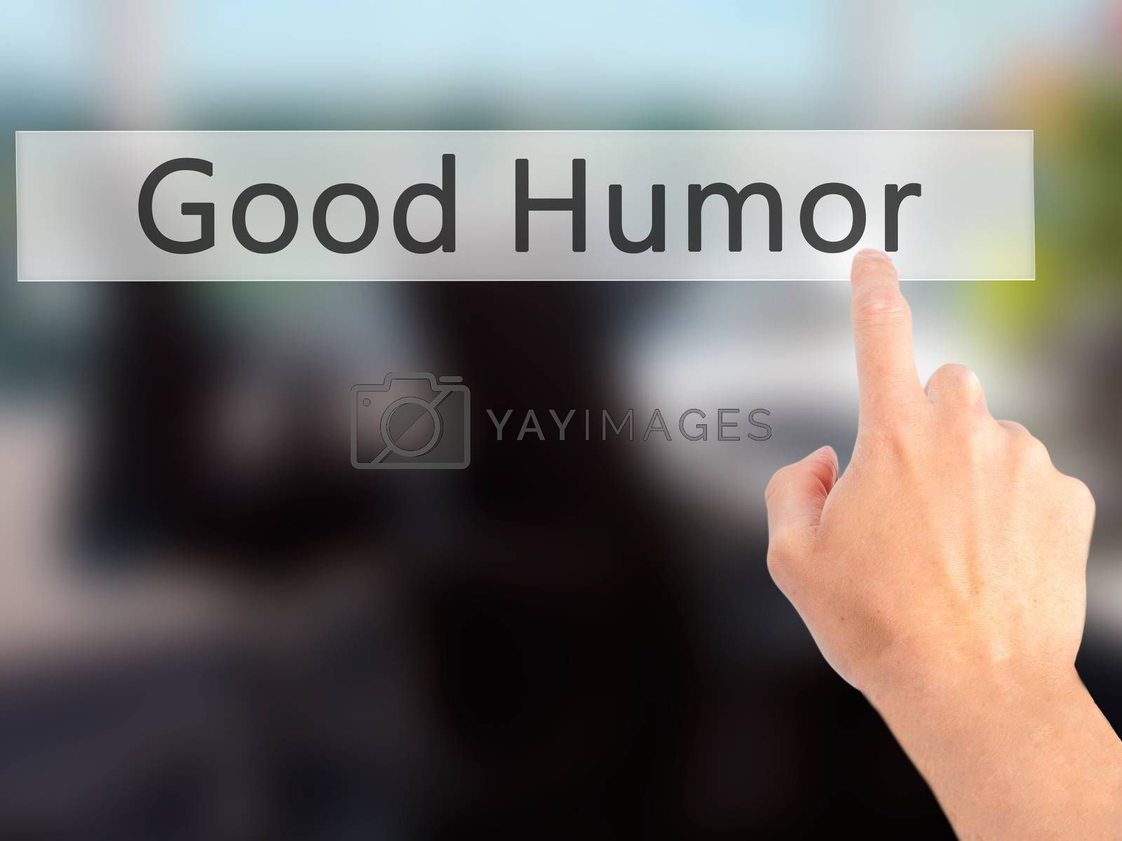 Good Humor - Hand pressing a button on blurred background concep by jackald