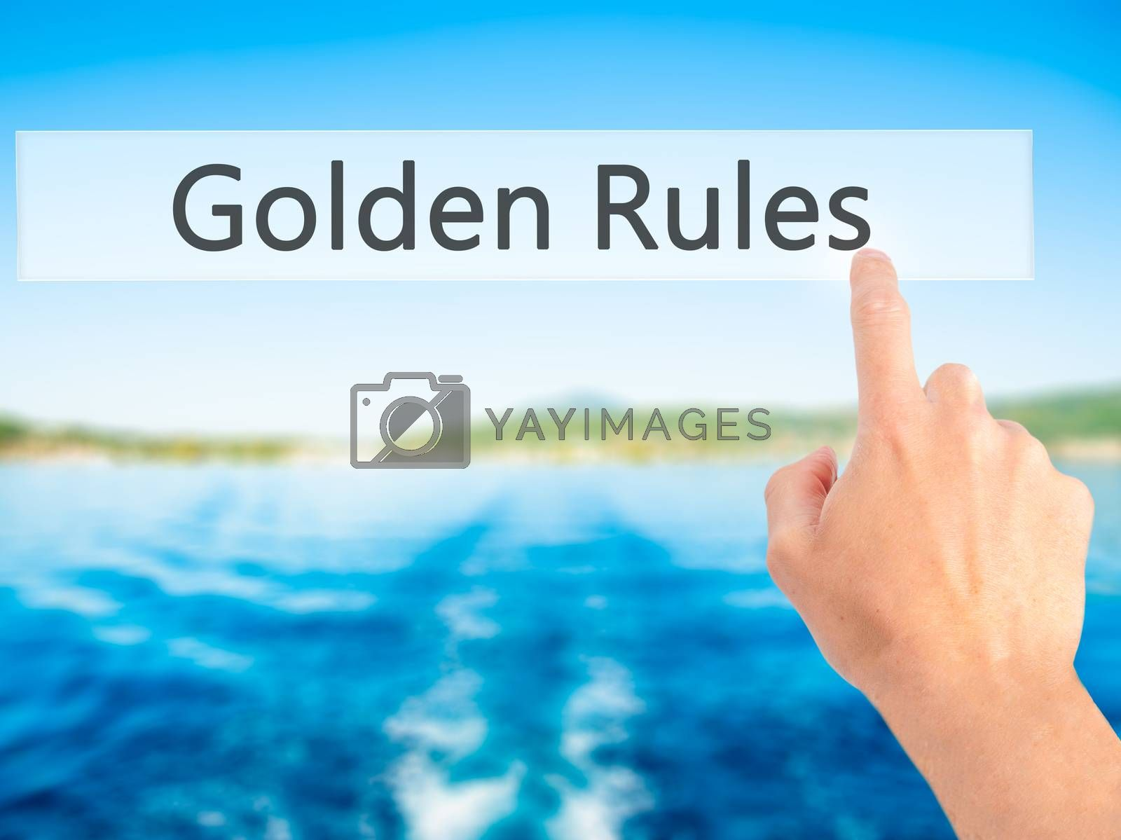 Golden Rules - Hand pressing a button on blurred background conc by netsay.net