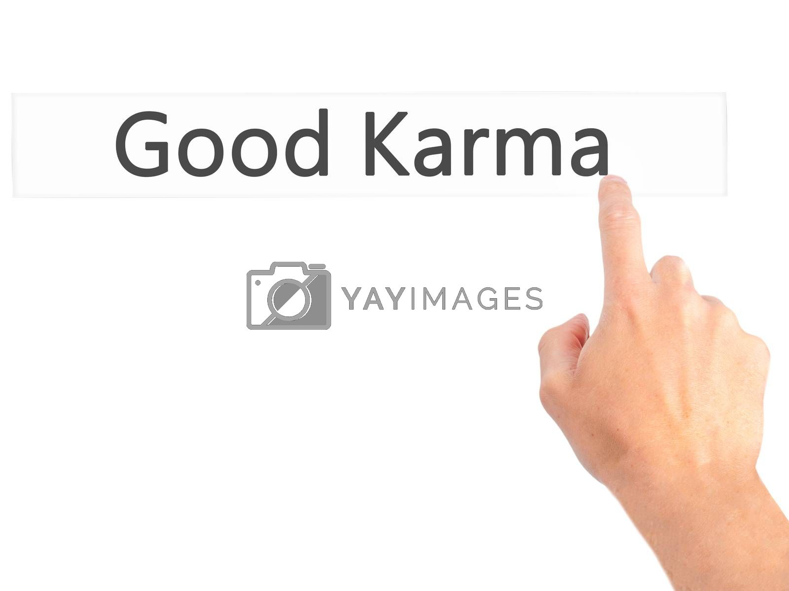 Good Karma - Hand pressing a button on blurred background concep by jackald
