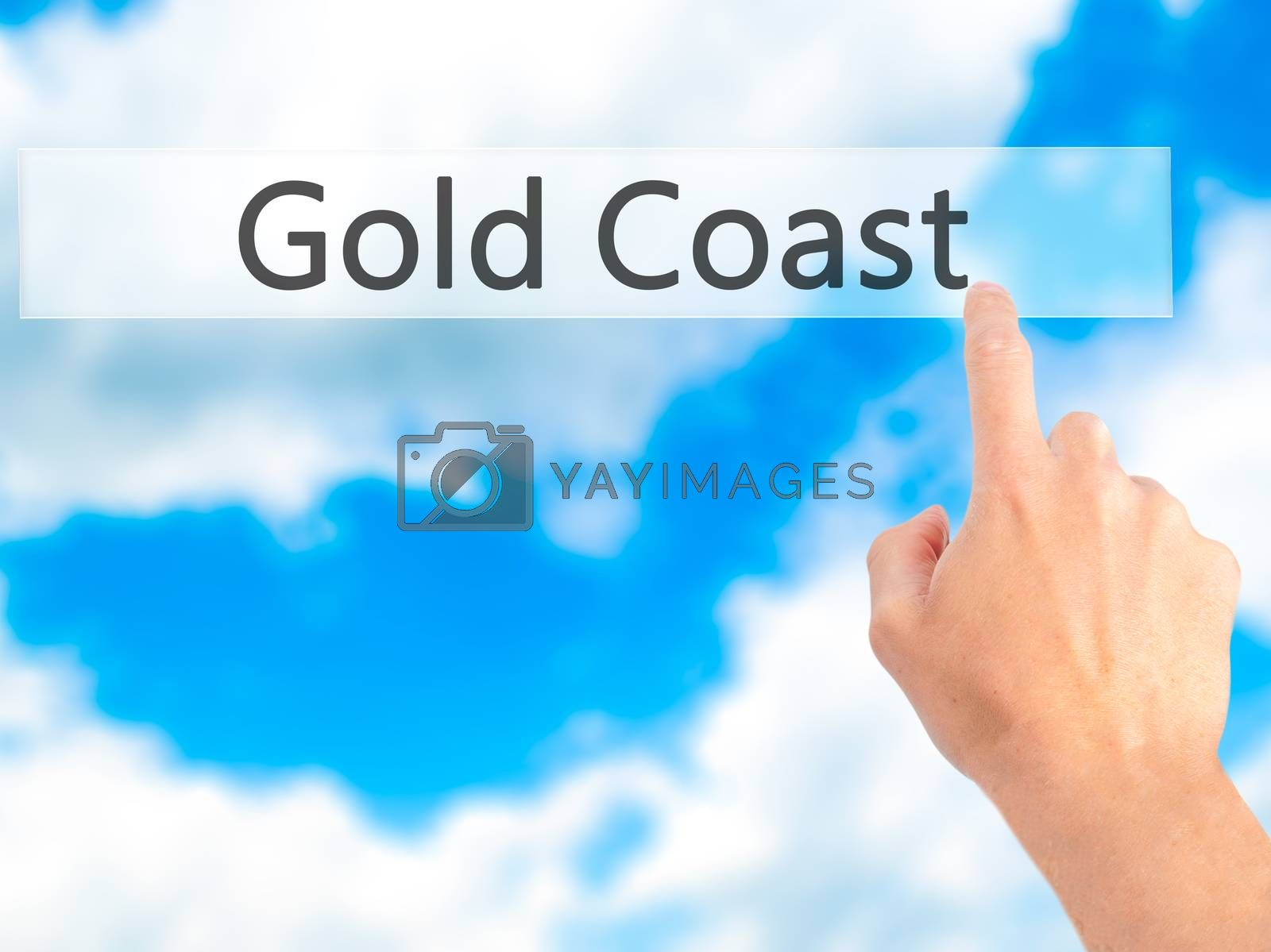 Gold Coast  - Hand pressing a button on blurred background conce by jackald