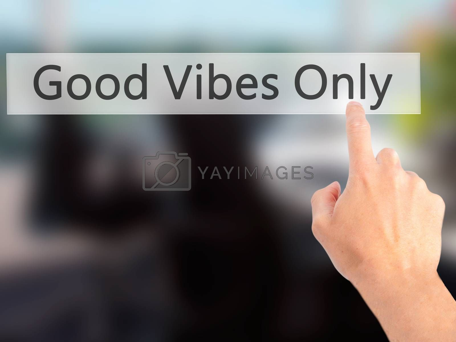Good Vibes Only - Hand pressing a button on blurred background c by jackald