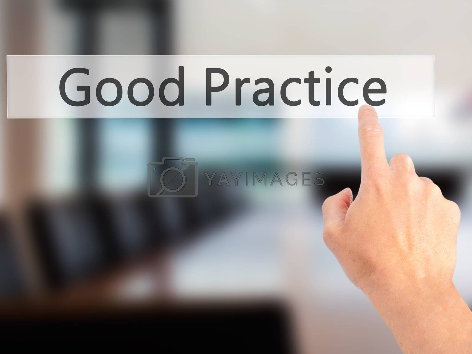 Good Practice - Hand pressing a button on blurred background con by jackald
