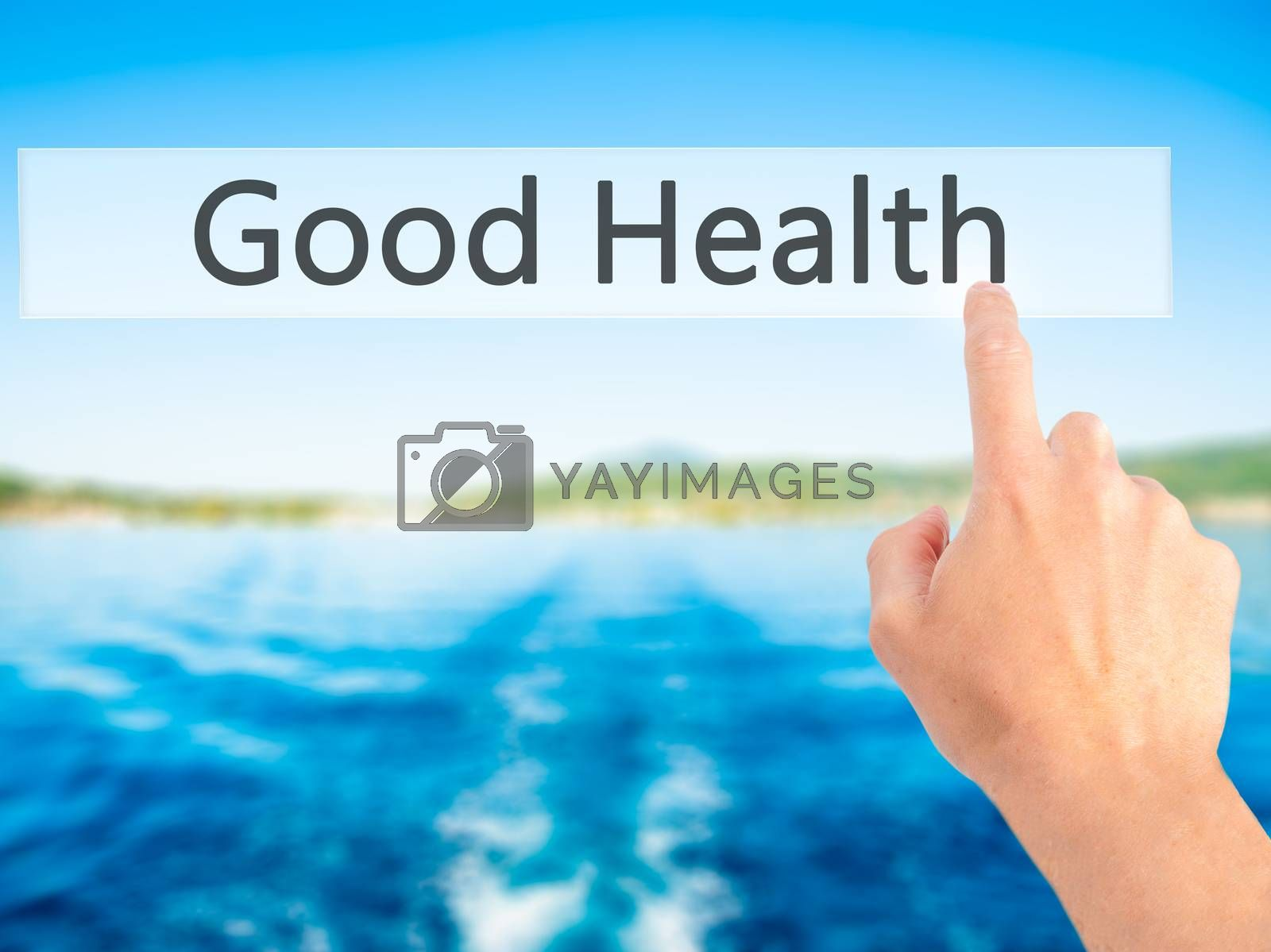 Good Health - Hand pressing a button on blurred background conce by netsay.net