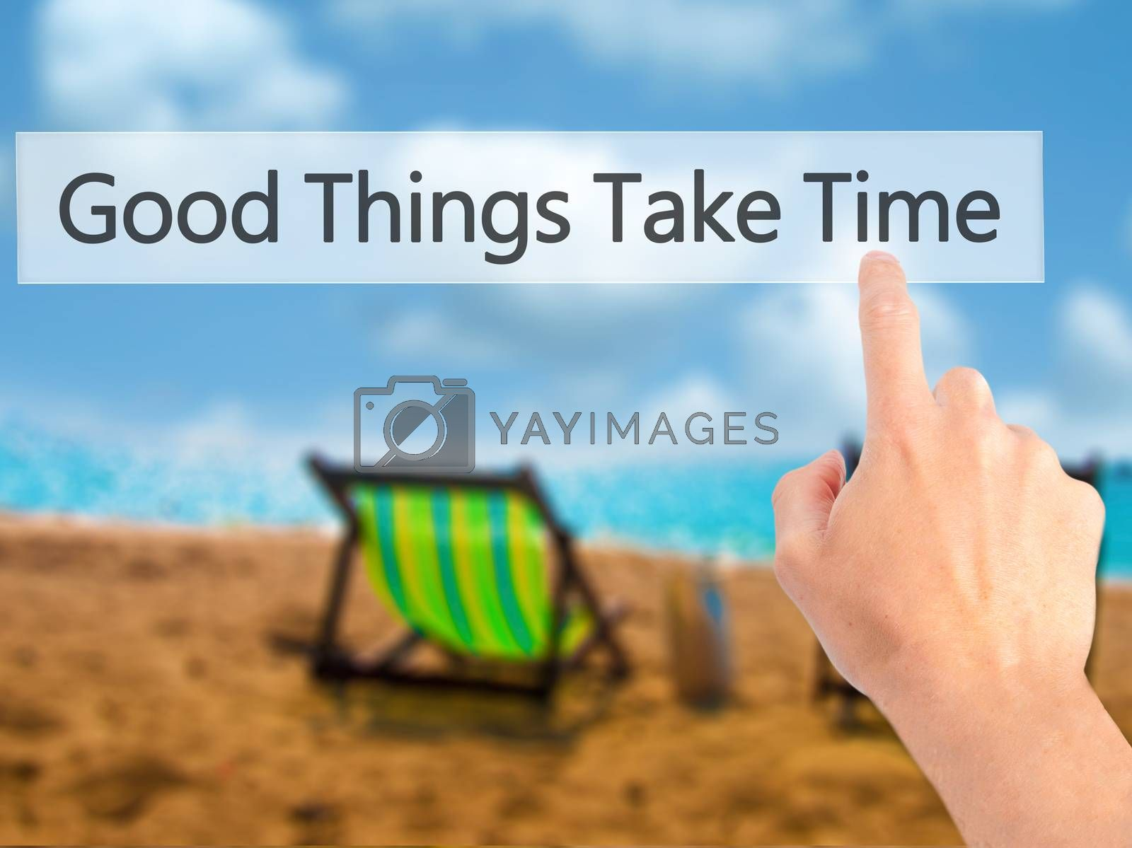 Good Things Take Time - Hand pressing a button on blurred backgr by jackald