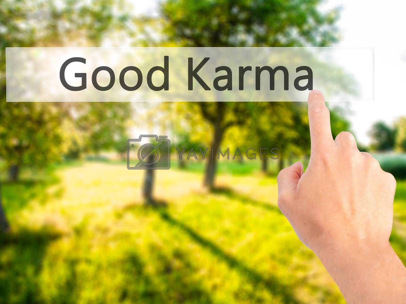 Good Karma - Hand pressing a button on blurred background concep by netsay.net