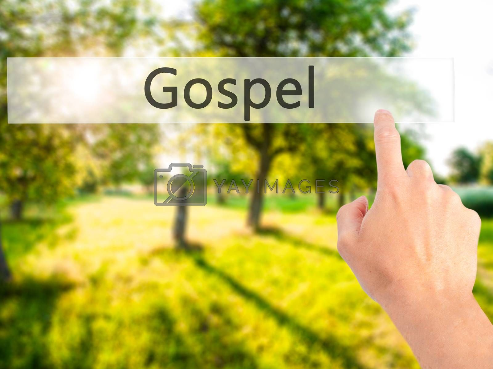 Gospel - Hand pressing a button on blurred background concept on by jackald